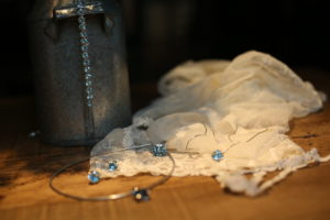 banner with lace and blue topaz jewellery from Desert Diamonds