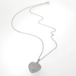 carp link chain featuring a stunning heart shaped diamond simulant studded pendant