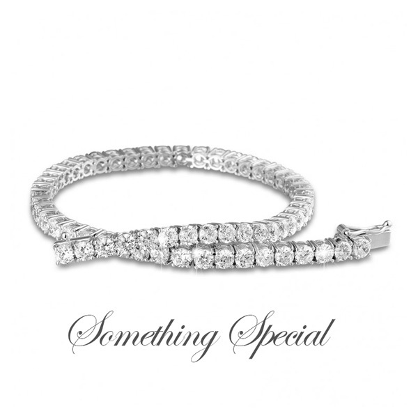"gorgeous diamond tennis bracelet with the tag ""something special"""