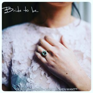 Bride to be promotional image of woman wearing a large blue gem ring wiht her hand elegantly placed across her chest