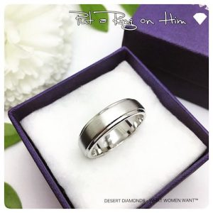 brushed silver men's wedding band set on a white cushioned desert diamonds gift box