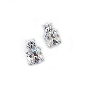 Meghan Markle inspired diamond simulant earrings featuring a large cushion cut diamond simulant stone with a smaller brilliant cut stone, both double 4 prong set in sterling silver with white gold plating