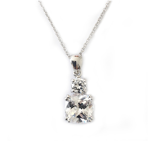 Meghan Markle inspired diamond simulant drop pendant featuring a large cushion cut diamond simulant stone with a smaller brilliant cut stone, both double 4 prong set in sterling silver with white gold plating