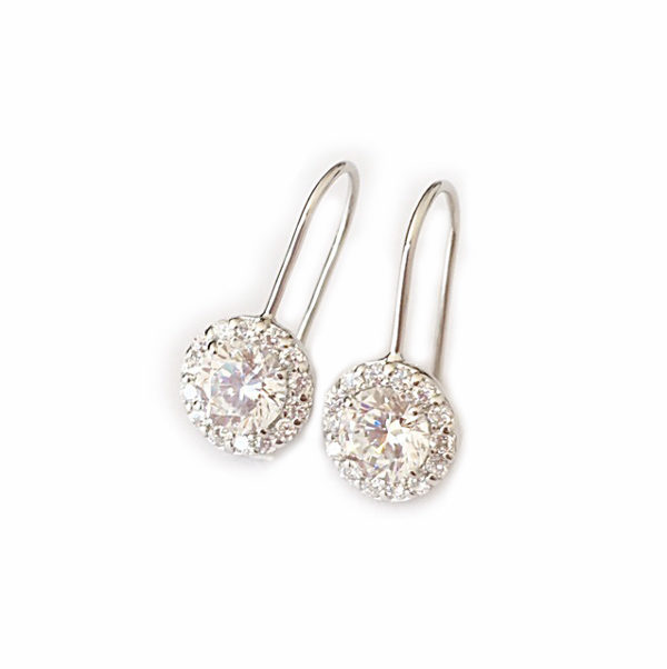 a pair of large halo hook drop diamond earrings in sterling silver
