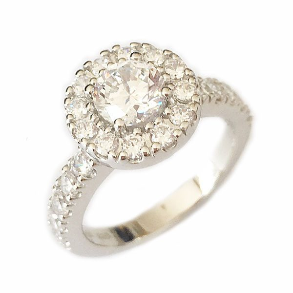 stunning antique style halo engagement ring showing large diamond surrounded by 12 smaller diamonds on a half band of 5 more smaller diamond simulants on either side